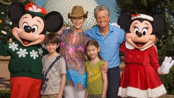 Catherine Zeta-Jones and Michael Douglas pose with their children, Dylan (left), age 10, and Carys (right), age 7, on Nov. 24, 2010, along with Mickey Mouse and Minnie Mouse in front of the Epcot theme park Christmas tree in Lake Buena Vista, Fla. - Provided courtesy of Kent Phillips / Walt Disney World