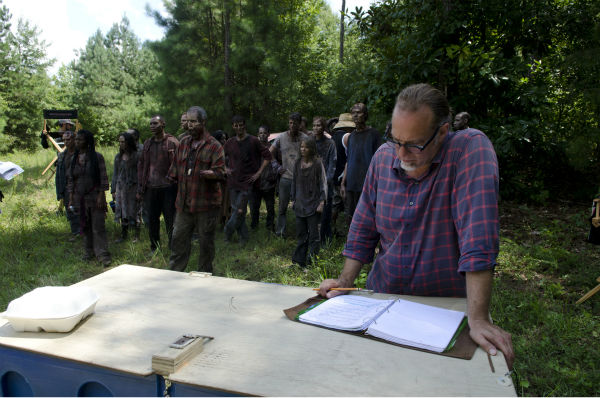 "<div class=""meta ""><span class=""caption-text "">Co-Executive Producer/SFX Makeup Supervisor Greg Nicotero and actors dressed as Walkers appear on the set of AMC's 'The Walking Dead's season 4 midseason premiere, titled 'After,' which aired on Feb. 9, 2014. (Gene Page / AMC)</span></div>"