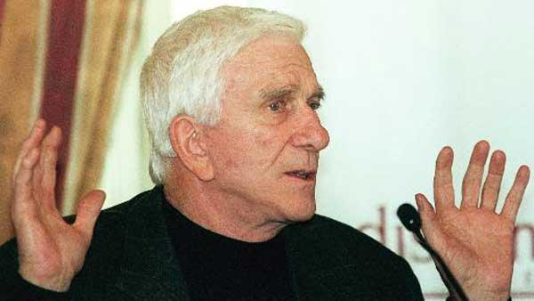 U.S. actor Leslie Nielson gestures during a press conference at a Viennese hotel on Monday, April 19, 1999. Nielson died on Nov. 28, 2010, at the age of 84.