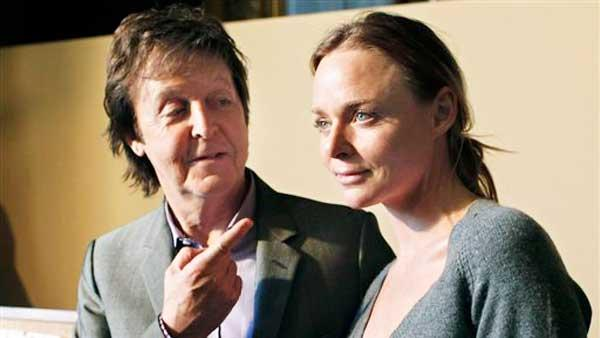 Paul McCartney and his daughter British fashion designer Stella McCartney pose after her fall-winter 2010-2011 ready to wear collecti