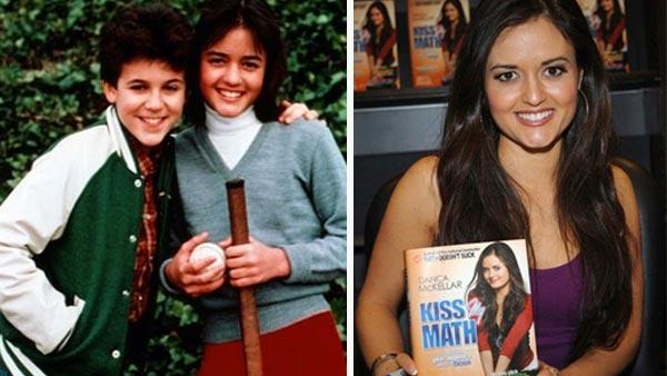Pictured: Danica McKellar and Fred Savage in a promotional photo for 'The Wonder Years'. / Danica McKellar at a book signing for her second book, 'Kiss My Math' in August 2008.