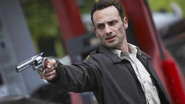 A promotional still of Andrew Lincoln holding a gun as Rick Grimes from The Walking Dead television series. - Provided courtesy of AMCtv.com/ Scott Garfield