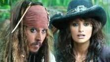 Captain Jack Sparrow (Johnny Depp) and Angelica (Penelope Cruz, not pictured) make their watery way through the jungle in search of the Fountain of Youth. - Provided courtesy of Peter Mountain / Disney Enterprises