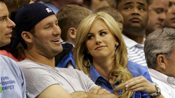 Tony Romo, left, sits with Candice Crawford during the first half of an NBA basketball game of the Dallas Mavericks and the Oklahoma City Thunder in Dallas on Saturday,