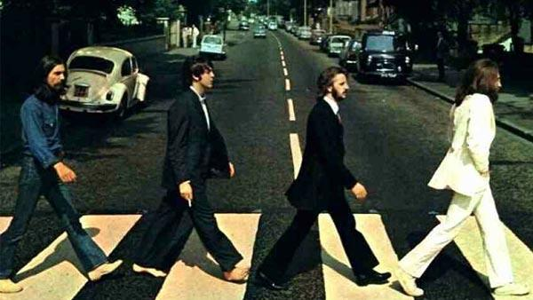 The Beatles band members are seen walking on the Abbey Road crosswalk in London in 1969. The photo appears as the cover of the groups 1969 album by the same name. - Provided courtesy of Capitol Records