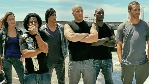 The cast, including Vin Diesel as 'Dominic Toretto', in a scene from the 2011  film, 'Fast Five.'