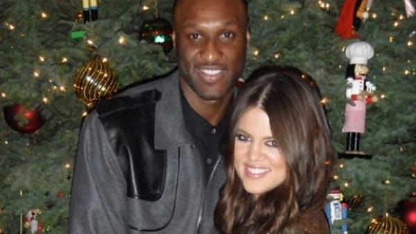 Khloe Kardashian and Lamar Odom appear in a Christmas photo posted on her website in December 2010. - Provided courtesy of khloekardashian.celebuzz.com