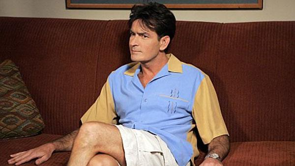 (Charlie Sheen in a production still for the show, 'Two and a Half Men'.)