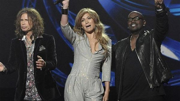 (Pictured: Steven Tyler, Jennifer Lopez and Randy Jackson cheer at an event announcing their participation in American Idol on Sept. 22, 2010.) - Provided courtesy of FOX