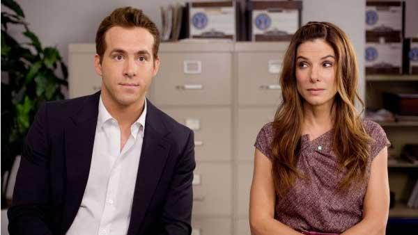 Ryan Reynolds and Sandra Bullock in a production still from the 2009 film The Proposal - Provided courtesy of Touchstone Pictures