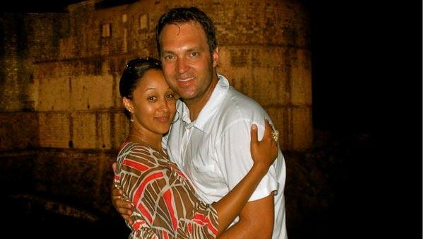 Tamera Mowry and fiance Adam Housley in a July 2010 photo from her Twitter page. - Provided courtesy of Twitpic.com/photos/TameraMowryTwo