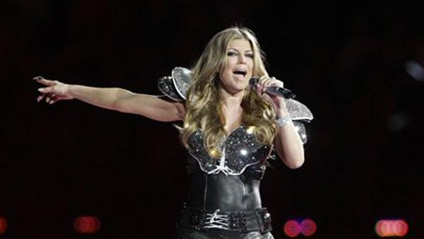 The Black Eyed Peas Fergie perfomrs with the band during halftime of the NFL Super Bowl XLV football game Sunday, Feb. 6, 2011, in Arlington, Texas. - Provided courtesy of AP