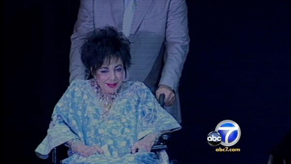 Elizabeth Taylor, then 77, appears in a wheelchair in 2009 before undergoing heart surgery at a Los Angeles hospital.