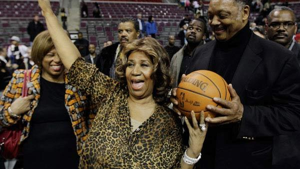 Aretha Franklin walks on the court with Jesse Jackson after the Detroit Pistons-Miami Heat NBA basketball game in Auburn Hills, Mich., Friday, Feb. 11, 2011. - Provided courtesy of AP / AP Photo/Paul Sancya