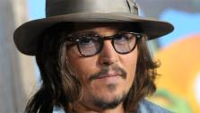 Johnny Depp arrives at the premiere of the animated feature film Rango in Los Angeles on Monday, February 14, 2011. - Provided courtesy of AP / Dan Steinberg