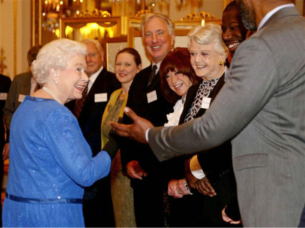 Queen Elizabeth II chats with Lenny Henry (British actor and Comic Relief charity co-founder), Steve McQueen ('12 Years A Slave' director), Dame Angela Lansbury ('Murder, She Wrote,' 'Beauty and the Beast'), Lynda La Plante (screenwriter of British series 'Prime Suspect') and Alan Rickman (Severus Snape in the 'Harry Potter' films, Hans Gruber in 'Die Hard') at the Reception for the Dramatic Arts at Buckingham Palace on Feb. 17, 2014.