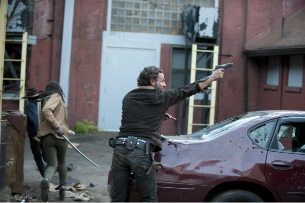 Rick Grimes &#40;Andrew Lincoln&#41; and Michonne &#40;Danai Gurira&#41; try to defend themselves from snipers in Terminus in this a scene from AMC&#39;s &#39;The Walking Dead&#39; season 4 finale, which aired on March 30, 2014. <span class=meta>(Gene Page &#47; AMC)</span>