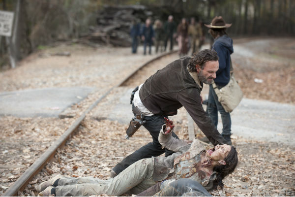 Rick Grimes &#40;Andrew Lincoln&#41; and Carl Grimes &#40;Chandler Riggs&#41; appear in a scene from AMC&#39;s &#39;The Walking Dead&#39; season 4 finale, which aired on March 30, 2014. <span class=meta>(Gene Page &#47; AMC)</span>