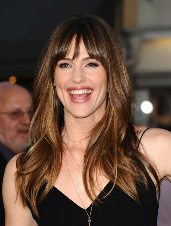 Jennifer Garner is smiling because she knows how perfect her hair is.  &#40;Pictured: Jennifer Garner appears at the premiere of &#39;Draft Day&#39; in Westwood, near Los Angeles, on April 7, 2014.&#41; <span class=meta>(Sara De Boer &#47; Startraksphoto.com)</span>