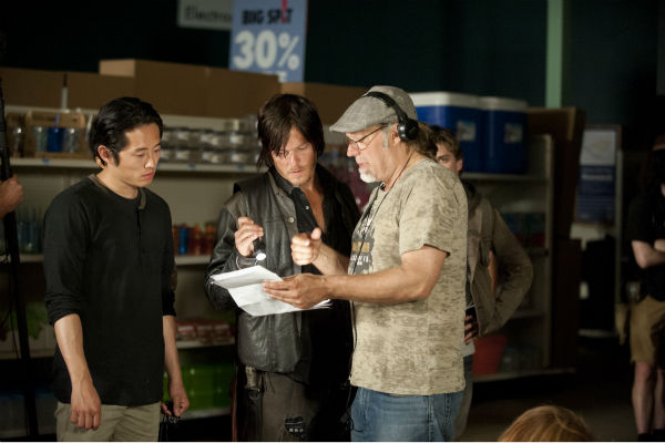 Steven Yeun &#40;Glenn&#41;, Norman Reedus &#40;Daryl Dixon&#41; and Co-Executive Producer&#47;SFX Makeup Supervisor Greg Nicotero appear on the set of AMC&#39;s &#39;The Walking Dead&#39; while filming episode 1 of season 4, titled &#39;30 Days Without an Accident,&#39; which aired on Oct. 13, 2013.  <span class=meta>(Gene Page &#47; AMC)</span>