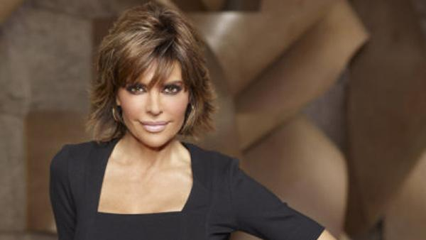 Lisa Rinna appears in a promotional photo for The Celebrity Apprentice in 2011. - Provided courtesy of NBC