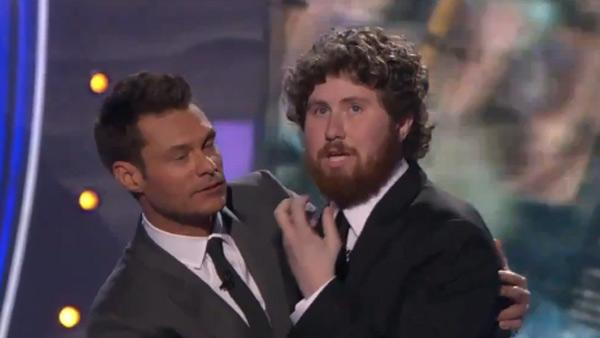 Casey Abrams holds onto American Idol host Ryan Seacrest after judges spare him from elimination on season 10s Top 11 Results Show on Thursday, March 24, 2011. - Provided courtesy of FOX