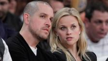 Actress Reese Witherspoon, right, and her fiance, Jim Toth, watch an NBA basketball game between Los Angeles Lakers and the Detroit Pistons in Los Angeles, Tuesday, Jan. 4, 2011. - Provided courtesy of AP / AP Photo/Jae C. Hong