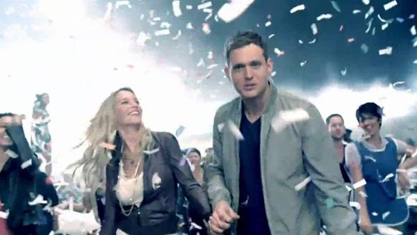 Michael Buble and Luisana Loreley Lopilato de la Torre in the music video for 'Haven't Met You Yet.'