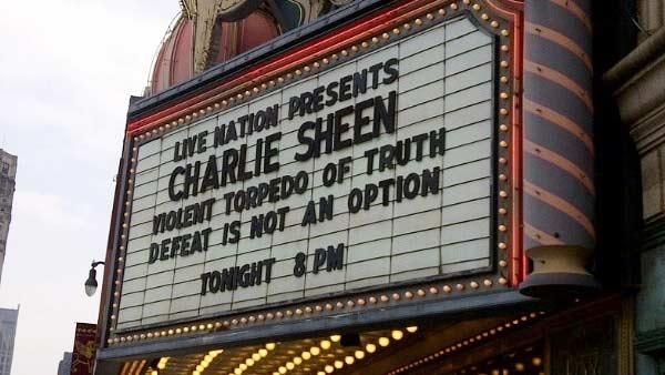 Charlie Sheen takes a photo of the Detroit marquee for his tour on April 2, 2011. - Provided courtesy of Twitter.com/charliesheen