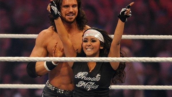 Nicole Snooki Polizzi raises her hands in victory along side WWE Superstar John Morrison after defeating LayCool in front of a sold-out, record crowd of 71,617 during WrestleMania XXVII at the Georgia Dome in Atlanta on Sunday, April 3, 2011. - Provided courtesy of AP Images for WWE/Paul Abell