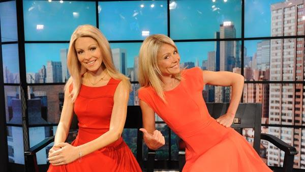 Co-host Kelly Ripa, right, poses with her wax likeness which was debuted during a broadcast of Live! with Regis and Kelly, Tuesday, April 5, 2011 in New York. The wax figure will be displayed at Madame Tussauds New York. - Provided courtesy of AP / Disney-ABC Domestic Television