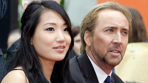 Alice Kim and Nicolas Cage at the ceremony where movie and television producer Jerry Bruckheimer added his hand and footprints in the forecourt of Graumans Chinese Theatre in the Hollywood district of Los Angeles Monday, May 17, 2010. - Provided courtesy of AP / AP Photo/Reed Saxon