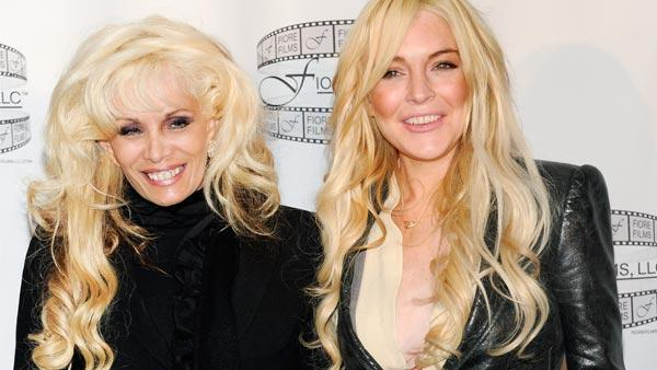 Television personality Victoria Gotti, left, and actress Lindsay Lohan participate in a press conference for the film Gotti: Three Generations, based on the life of John Gotti, at The Sheraton Hotel on Tuesday, April 12, 2011 in New York. - Provided courtesy of AP Photo/Evan Agostini