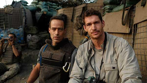 In this 2007 publicity image released by Outpost Films, directors Sebastian Junger, left, and Tim Hetherington are shown at the Restrepo outpost in the Korengal Valley, Afghanistan, during the filming of their documentary 'Restrepo.'
