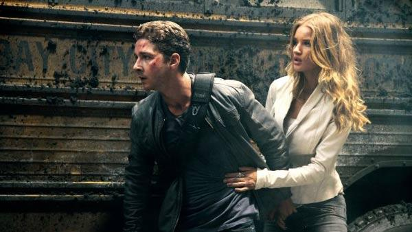 Shia LaBeouf and Rosie Huntington-Whiteley appear in a still from Transformers: Dark of the Moon. - Provided courtesy of Paramount Pictures