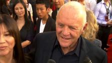 Anthony Hopkins speaks about working on the superhero movie Thor and how he wanted to get in on the action.
