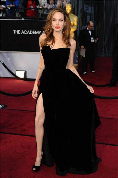 Angelina Jolie poses on the red carpet at the 2012 Oscars in Hollywood, California on Feb. 26, 2012.