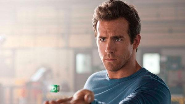 Ryan Reynolds (right) in a scene from the 2011 film, Green Lantern. - Provided courtesy of OTRC