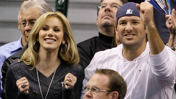 Dallas Cowboys quarterback Tony Romo, right, reacts to a shot by the Dallas Mavericks as he and his fiancee, Candice Crawford, left, take in the Mavericks NBA basketball game against the Los Angeles Lakers on Wednesday, Jan. 19, 2011, in Dallas. - Provided courtesy of AP / AP Photo/Tony Gutierrez
