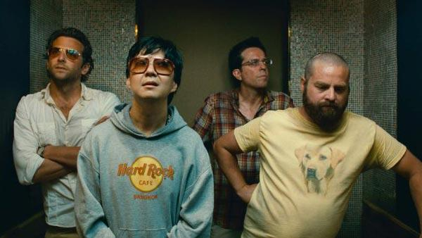 Bradley Cooper, Ken Jeong, Ed Helms and Zach Galifianakis appear in a still from their 2011 film, The Hangover Part II. - Provided courtesy of Warner Bros. Pictures
