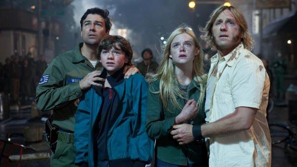 Kyle Chandler, Joel Courtney, Elle Fanning and Ron Eldard appear in a still from Super 8. - Provided courtesy of Paramount Pictures / Francois Duhamel