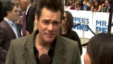 Jim Carrey talks to OnTheRedCarpet.com at the Hollywood premiere of Mr. Poppers Penguins. - Provided courtesy of OTRC