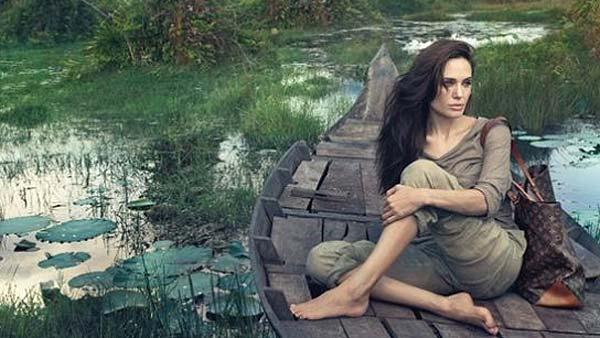 Angelina Jolie appears in a photo touting fashion giant Louis Vuitton 2011 Core Values campaign. - Provided courtesy of Louis Vuitton / Annie Leibovitz