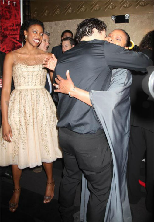 Orlando Bloom hugs 'Cosby Show' alum Phylicia Rashad at the opening night party for the play 'Romeo and Juliet,' which marks the actor's Broadway debut, in New York on Sept. 19, 2013. Pictured left is his