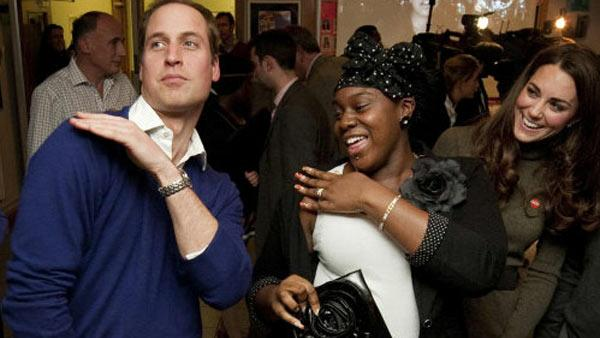 Prince William dances the Swag Dance with Vanessa Boateng as his wife, Kate, the Duchess of Cambridge, looks on during their visit to Centrepoints Camberwell Foyer in London on Dec. 21, 2011. - Provided courtesy of Prince of Wales Media Centre