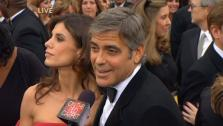 Best Actor nominee George Clooney and girlfriend Elisabetta Canalis walk the red carpet before the 82nd Academy Awards on March 7, 2011 - Provided courtesy of OTRC