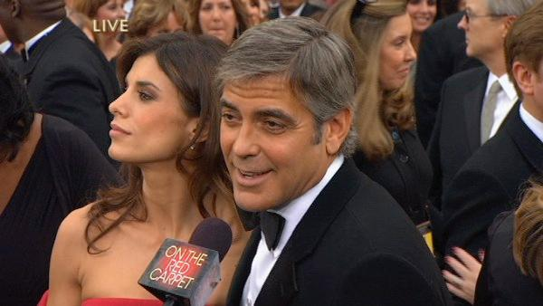 Best Actor nominee George Clooney and girlfriend Elisabetta Canalis walk the red carpet before the 82nd Academy Awards on March 7, 2011