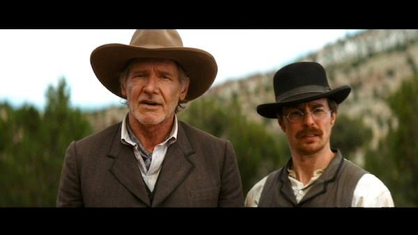 Harrison Ford and Sam Rockwell appear in a still from Cowboys and Aliens - Provided courtesy of Universal Pictures
