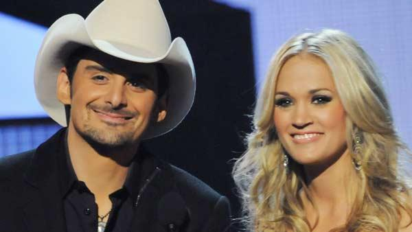 Brad Paisley and Carrie Underwood appear in a promotional photo for the 2010 CMA Awards. - Provided courtesy of Country Music Association