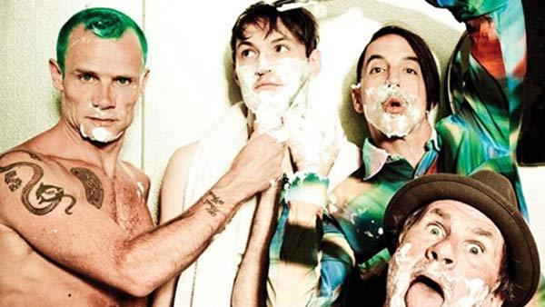 The Red Hot Chili Peppers - Anthony Kiedis, Josh Klinghoffer, Michael Flea Balzary and Chad Smith appear in a promotional photo for their single, The Adventures of Rain Dance Maggie. - Provided courtesy of Warner Bros. Records